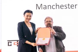 Charlotte Shi from Manchester Airport collects the award in Shanghai
