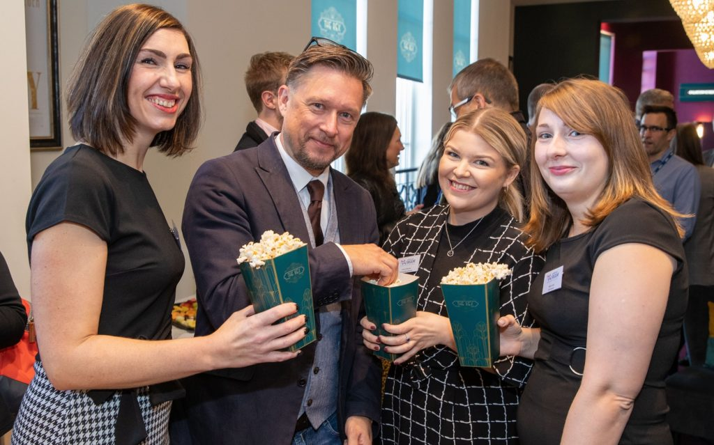Guests from member companies Synergy Recruitment and SAS Daniels enjoy popcorn with Marketing WAM Director Richard Higginson