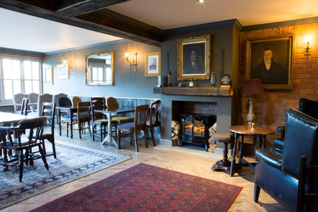 New fireplace and seating at Alderley Edge pub, The Drum and Monkey