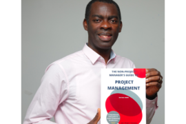 Airport project manager Sam Buah with his new book